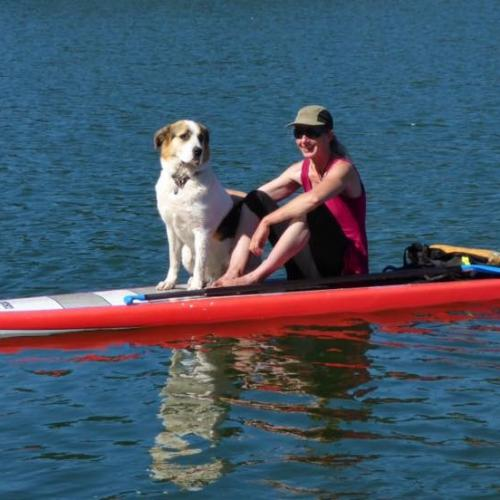 Claudia and her dog Yoda go everywhere together...even on a SUP