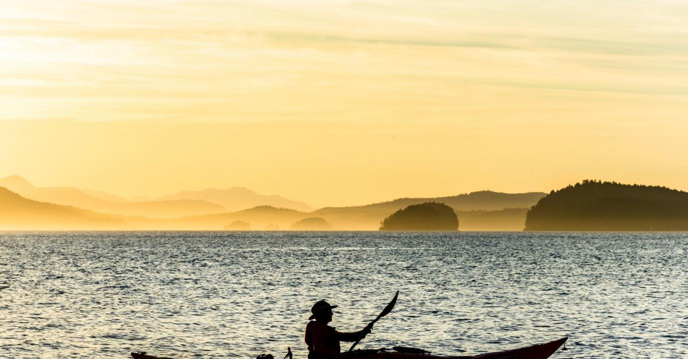 Kayak silhouette, sunset kayak tour, Pender Island Kayak Adventures.